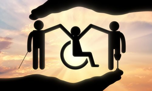 Disabled society to hold hands in handbreadth against backdrop sunset. Concept help disabled persons