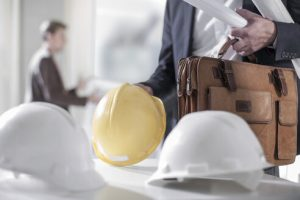 man-holding-briefcase-and-hard-hat-ZEF008159